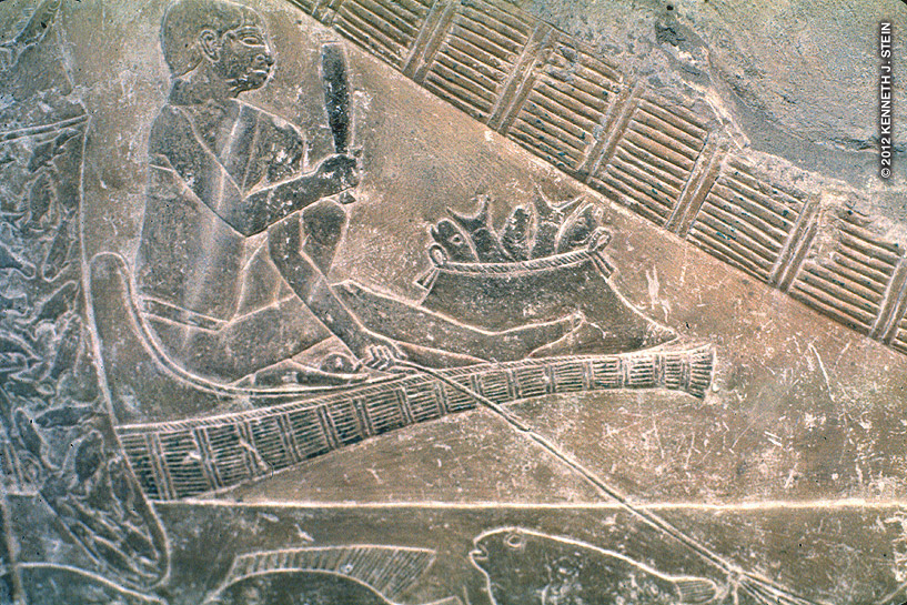 Idut was a queen and the daughter of King Djoser (2323 BC). The man fishes from a papyrus boat with a fishing line in one hand and a club in the other. Note the basket of fish.